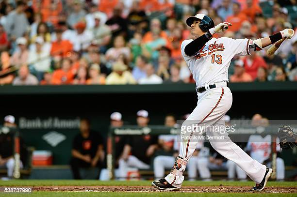 Manny Machado of the Baltimore Orioles hits a fly ball out to left field in the second inning during a MLB baseball game against the Kansas City...
