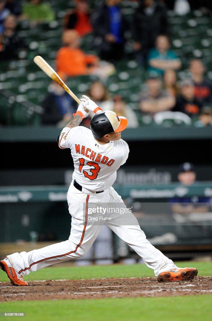 Manny Machado #13 of the Baltimore Orioles hits a home run in the eighth inning against the Seattle Mariners at Oriole Park at Camden Yards on August 29, 2017 in Baltimore, Maryland.