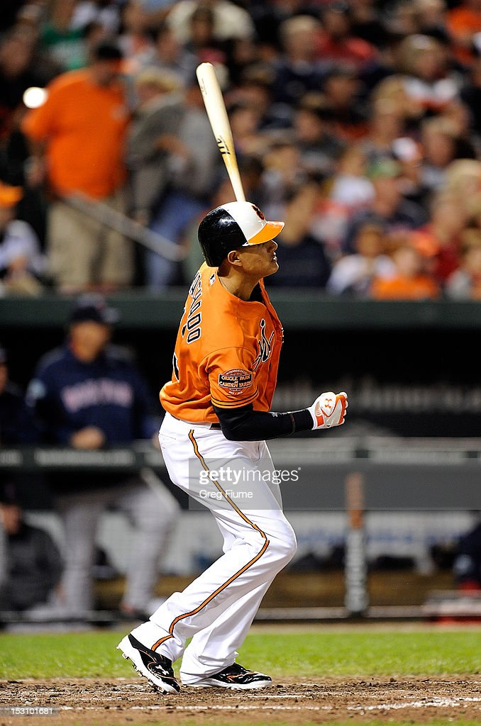 Manny Machado #13 of the Baltimore Orioles hits a home run in the seventh inning against the Boston Red Sox at Oriole Park at Camden Yards on September 29, 2012 in Baltimore, Maryland. Baltimore won the game 4-3.