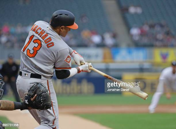 Manny Machado of the Baltimore Orioles hits a run scoring single in the 1st inning against the Chicago White Sox at Guarantedd Rate Field on June 13...