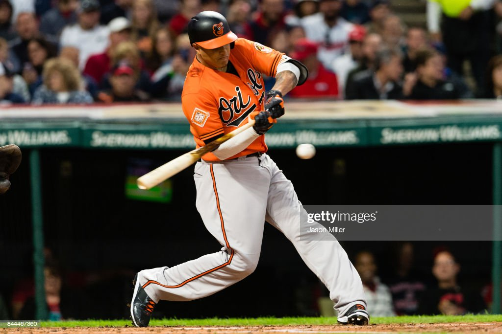 Manny Machado #13 of the Baltimore Orioles hits a single during the third inning against the Cleveland Indians at Progressive Field on September 8, 2017 in Cleveland, Ohio.