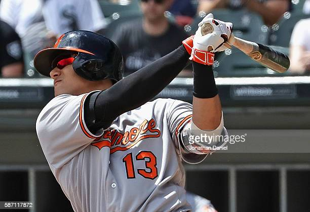 Manny Machado of the Baltimore Orioles hits a solo home run in the 1st inning against the Chicago White Sox at US Cellular Field on August 7 2016 in...