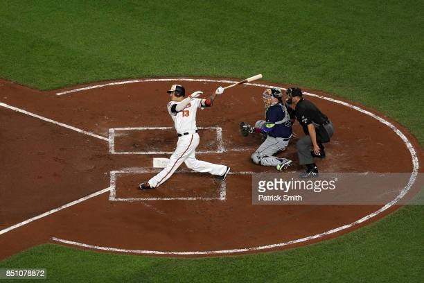 Manny Machado of the Baltimore Orioles hits a two run home run during the first inning against the Tampa Bay Rays at Oriole Park at Camden Yards on...
