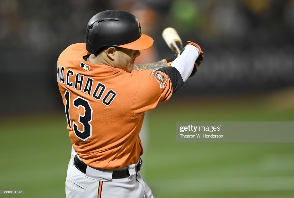 Manny Machado #13 of the Baltimore Orioles hits an rbi single scoring Tim Beckham #1 against the Oakland Athletics in the top of the ninth inning at Oakland Alameda Coliseum on August 12, 2017 in Oakland, California. The Orioles won the game 12-5.