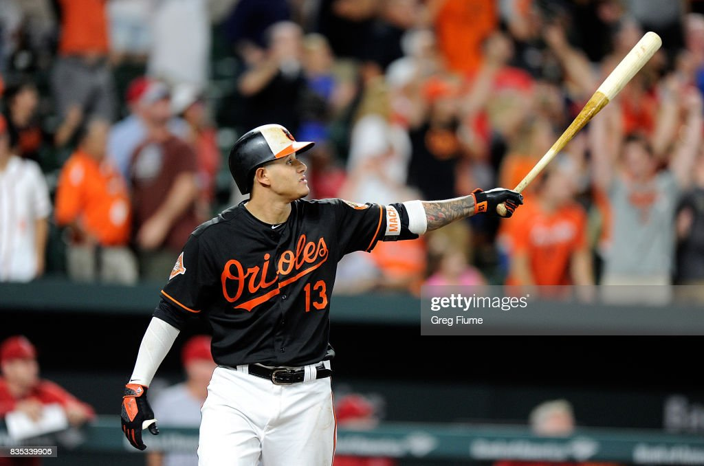 Manny Machado #13 of the Baltimore Orioles hits the game winning grand slam in the ninth inning against the Los Angeles Angels at Oriole Park at Camden Yards on August 18, 2017 in Baltimore, Maryland. Baltimore won the game 9-7.
