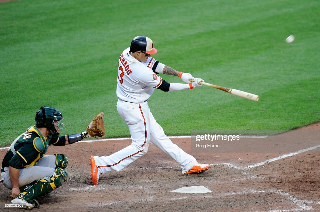 Manny Machado #13 of the Baltimore Orioles hits the game-winning home run in the 12th inning against the Oakland Athletics at Oriole Park at Camden Yards on August 23, 2017 in Baltimore, Maryland. Baltimore won the game 8-7.