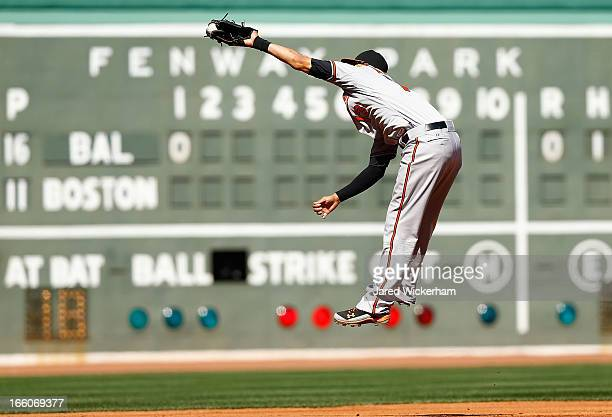Manny Machado of the Baltimore Orioles jumps up to catch a line drive at third base against the Boston Red Sox during the Opening Day game on April 8...