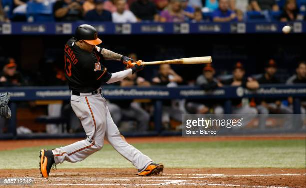 Manny Machado of the Baltimore Orioles lines out to left fielder Cesar Puello of the Tampa Bay Rays during the seventh inning of a game on September...