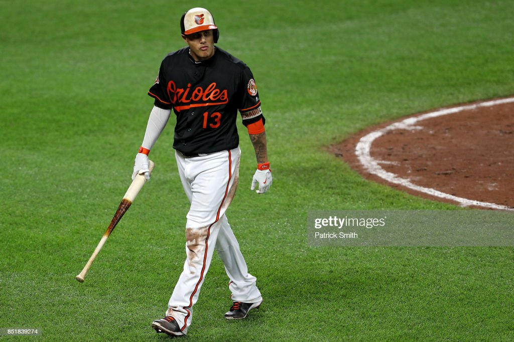 Manny Machado #13 of the Baltimore Orioles looks on after striking out during the seventh inning against the Tampa Bay Rays at Oriole Park at Camden Yards on September 22, 2017 in Baltimore, Maryland.