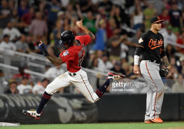 Manny Machado of the Baltimore Orioles looks on as Byron Buxton of the Minnesota Twins rounds third base on his way to score a run during the eighth...