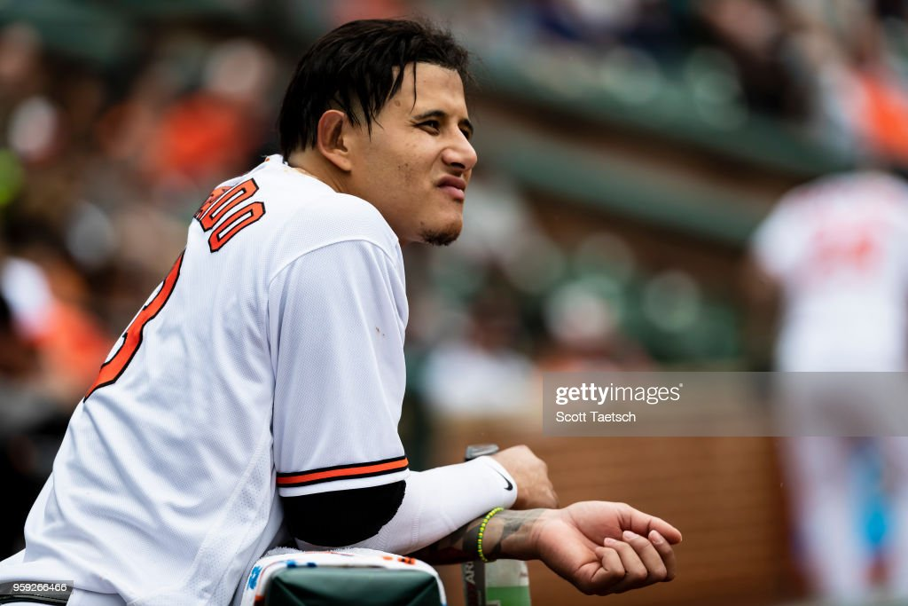 Manny Machado #13 of the Baltimore Orioles looks on during the eighth inning against the Philadelphia Phillies at Oriole Park at Camden Yards on May 16, 2018 in Baltimore, Maryland.