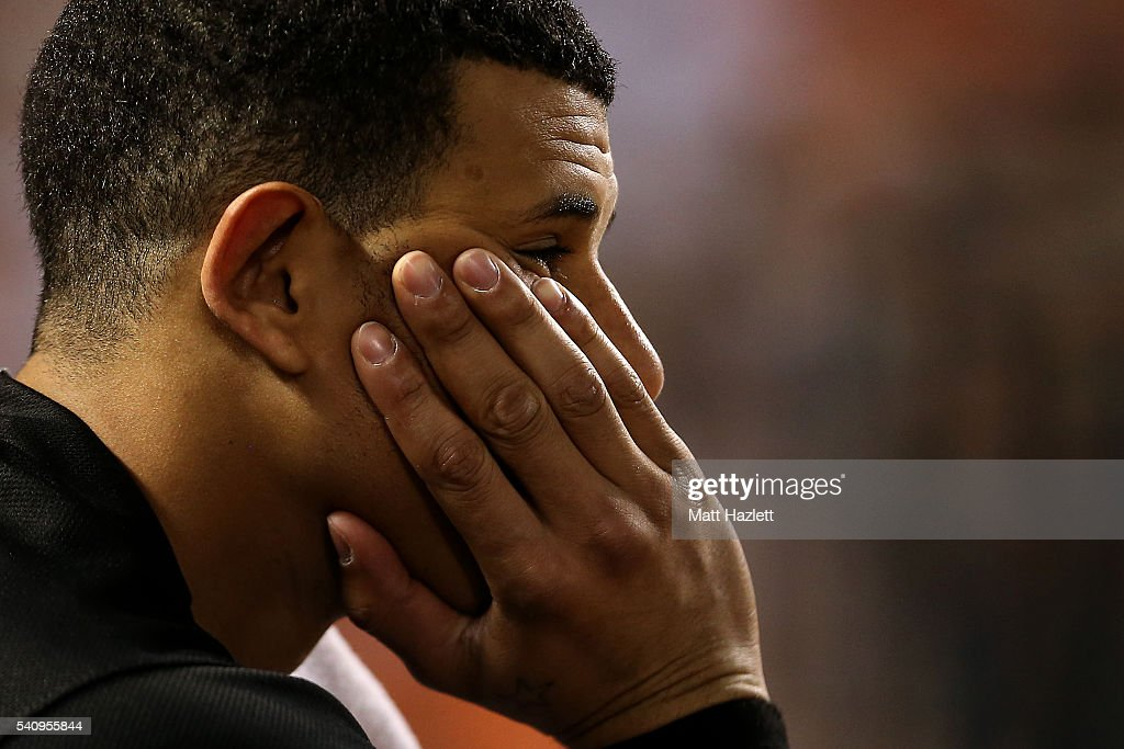 Manny Machado #13 of the Baltimore Orioles looks on from the dug out in the sixth inning against the Toronto Blue Jays at Oriole Park at Camden Yards on June 17, 2016 in Baltimore, Maryland.