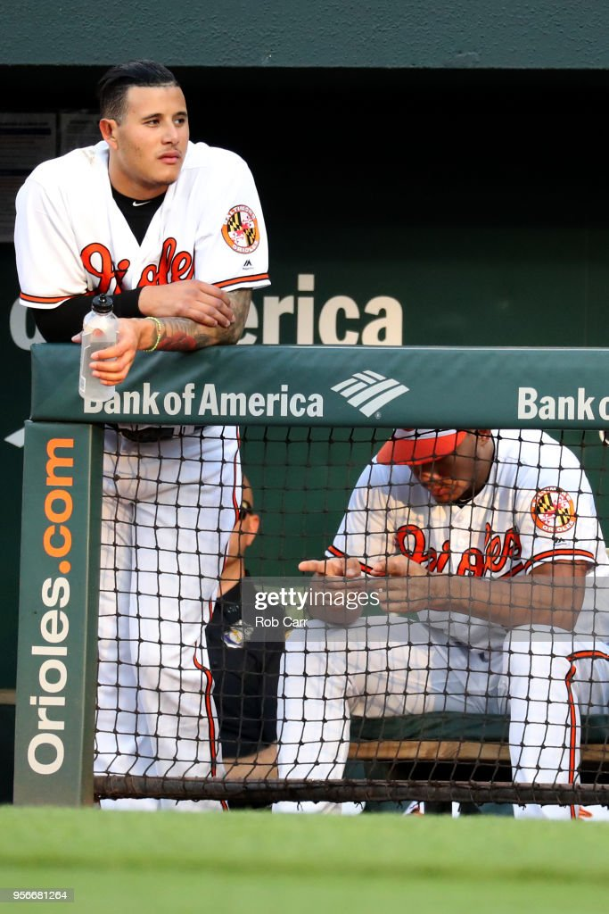 Manny Machado #13 of the Baltimore Orioles looks on from the dugout in the first inning against the Kansas City Royals at Oriole Park at Camden Yards on May 9, 2018 in Baltimore, Maryland.