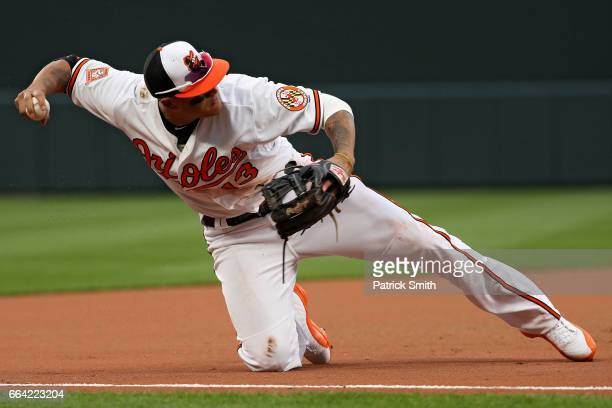 Manny Machado of the Baltimore Orioles makes a play on a hit by Devon Travis of the Toronto Blue Jays during the eleventh inning in their Opening Day...