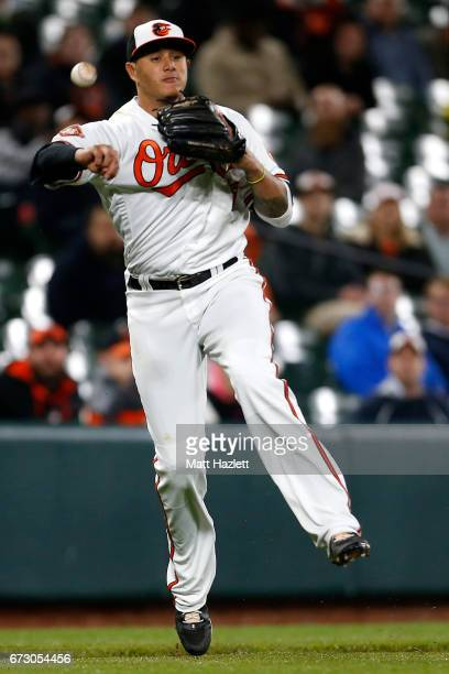 Manny Machado of the Baltimore Orioles makes a throw to first base for the third out of the seventh inning against the Tampa Bay Rays at Oriole Park...