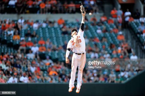 Manny Machado of the Baltimore Orioles misses a ball off the bat of Boog Powell of the Oakland Athletics in the sixth inning at Oriole Park at Camden...