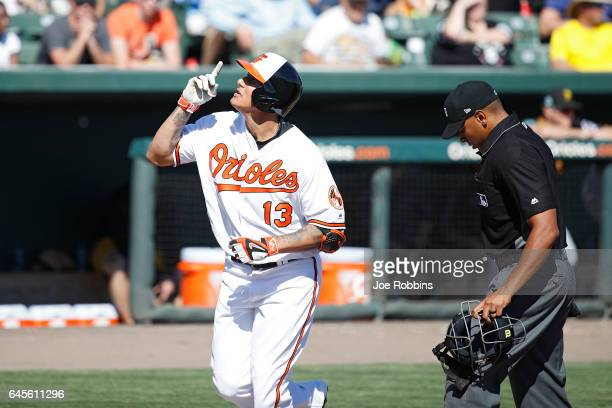 Manny Machado of the Baltimore Orioles reacts after a solo home run in the fifth inning of a spring training game against the Pittsburgh Pirates at...
