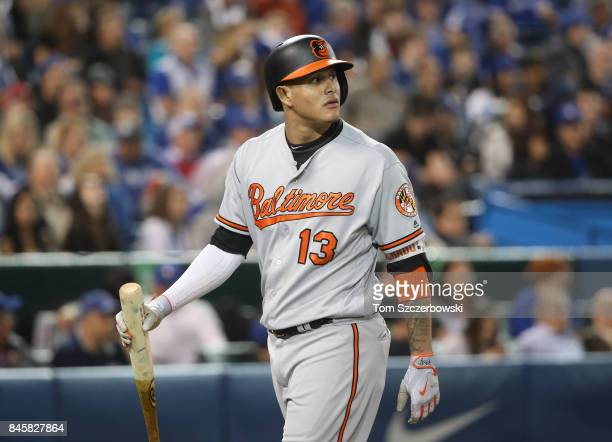 Manny Machado of the Baltimore Orioles reacts after being called out on strikes in the sixth inning during MLB game action against the Toronto Blue...