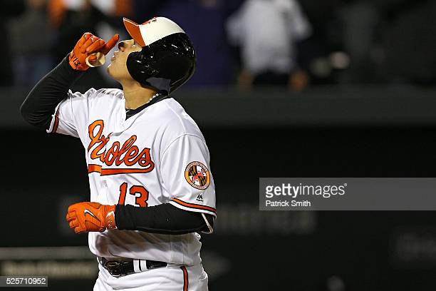 Manny Machado of the Baltimore Orioles reacts after hitting a grand slam home run against the Chicago White Sox in the sixth inning at Oriole Park at...