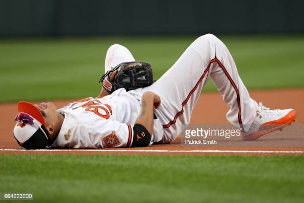 Manny Machado of the Baltimore Orioles reacts after making a play on a hit by Devon Travis of the Toronto Blue Jays during the eleventh inning in...