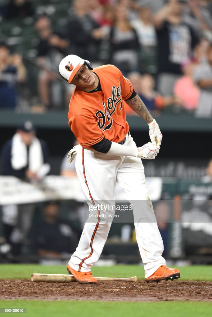 Manny Machado #13 of the Baltimore Orioles reacts after striking out for last out of the game in the ninth inning during a baseball game against the New York Yankees at Oriole Park at Camden Yards on June 2, 2018 in Baltimore, Maryland.