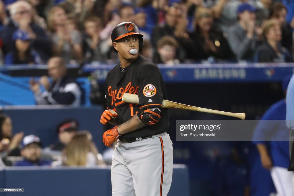 Manny Machado #13 of the Baltimore Orioles reacts after striking out in the seventh inning during MLB game action against the Toronto Blue Jays at Rogers Centre on April 14, 2017 in Toronto, Canada.