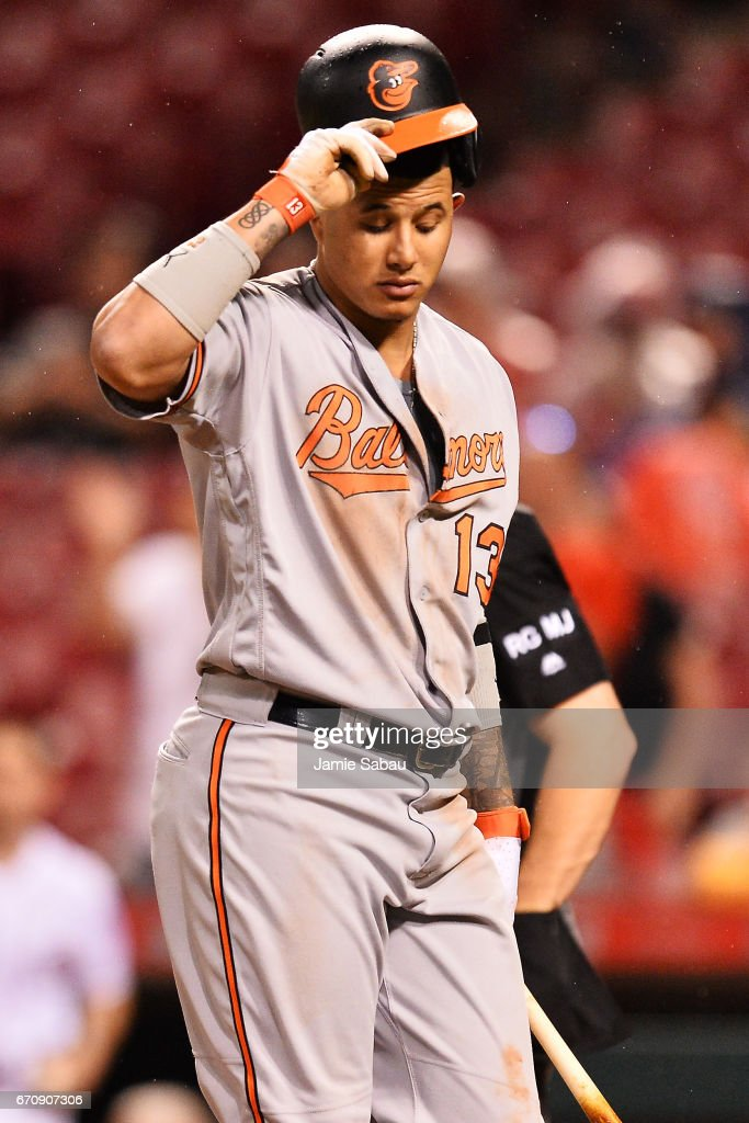 Manny Machado #13 of the Baltimore Orioles reacts after striking out in the ninth inning against the Cincinnati Reds at Great American Ball Park on April 20, 2017 in Cincinnati, Ohio. Baltimore defeated Cincinnati 2-1 in 10 innings.