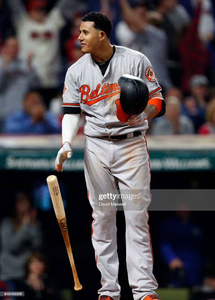 Manny Machado #13 of the Baltimore Orioles reacts after striking out against the Cleveland Indians in the eighth inning at Progressive Field on September 10, 2017 in Cleveland, Ohio. The Indians defeated the Orioles 3-2, and their win streak now stands at 18.