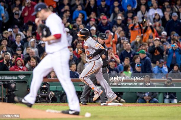Manny Machado of the Baltimore Orioles rounds the bases after hitting a three run home run off Kyle Kendrick of the Boston Red Sox during the fourth...
