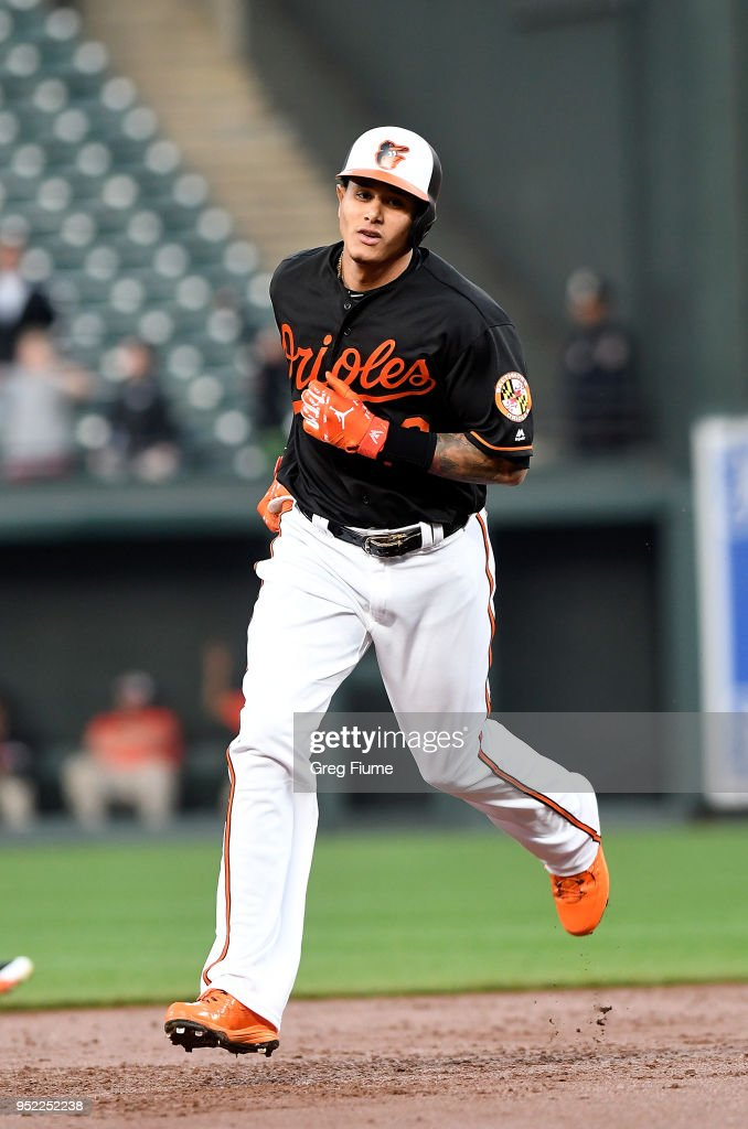 Manny Machado #13 of the Baltimore Orioles rounds the bases after hitting a home run in the first inning against the Detroit Tigers at Oriole Park at Camden Yards on April 27, 2018 in Baltimore, Maryland.