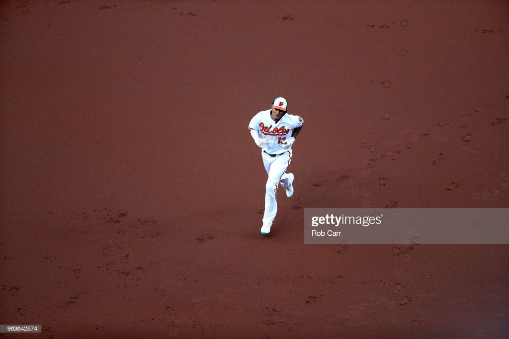 Manny Machado #13 of the Baltimore Orioles rounds the bases after hitting a solo home run against the Washington Nationals in the first inning at Oriole Park at Camden Yards on May 29, 2018 in Baltimore, Maryland.
