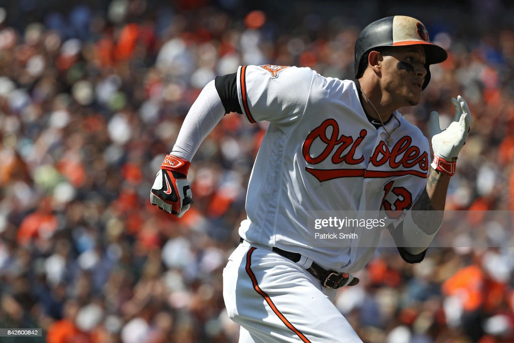 Manny Machado #13 of the Baltimore Orioles runs to first base as he singles against the New York Yankees during the first inning at Oriole Park at Camden Yards on September 4, 2017 in Baltimore, Maryland.