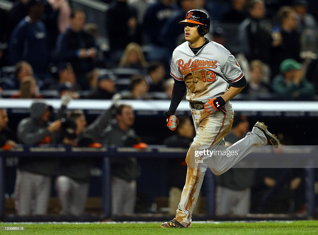 Manny Machado #13 of the Baltimore Orioles scores the game-winning run in the thirteenth inning in Game Four of the American League Division Series against the New York Yankees at Yankee Stadium on October 11, 2012 in the Bronx borough of New York City.