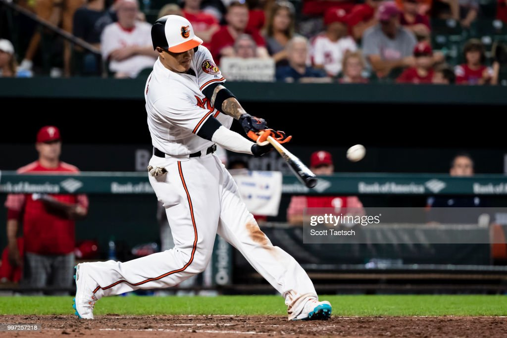 Manny Machado #13 of the Baltimore Orioles singles against the Philadelphia Phillies during the eighth inning at Oriole Park at Camden Yards on July 12, 2018 in Baltimore, Maryland.