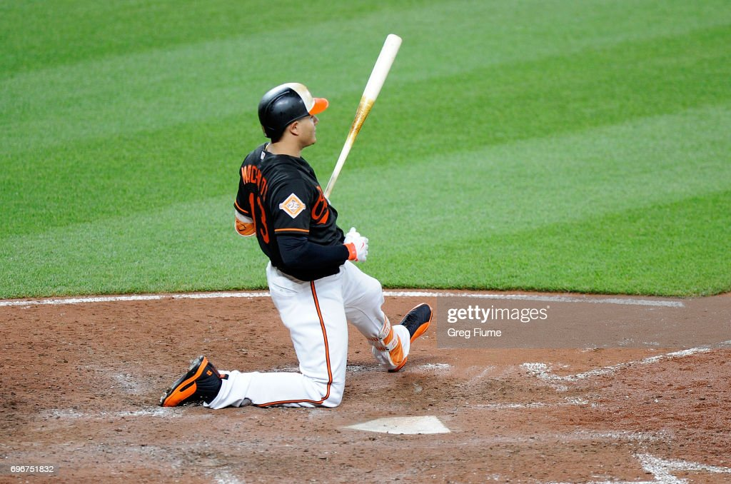 Manny Machado #13 of the Baltimore Orioles strikes out in the sixth inning against the St. Louis Cardinals at Oriole Park at Camden Yards on June 16, 2017 in Baltimore, Maryland. St. Louis won the game 11-2.