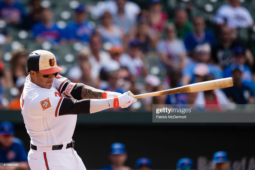 Manny Machado #13 of the Baltimore Orioles strikes out swinging in the ninth inning during a game against the Chicago Cubs at Oriole Park at Camden Yards on July 16, 2017 in Baltimore, Maryland.