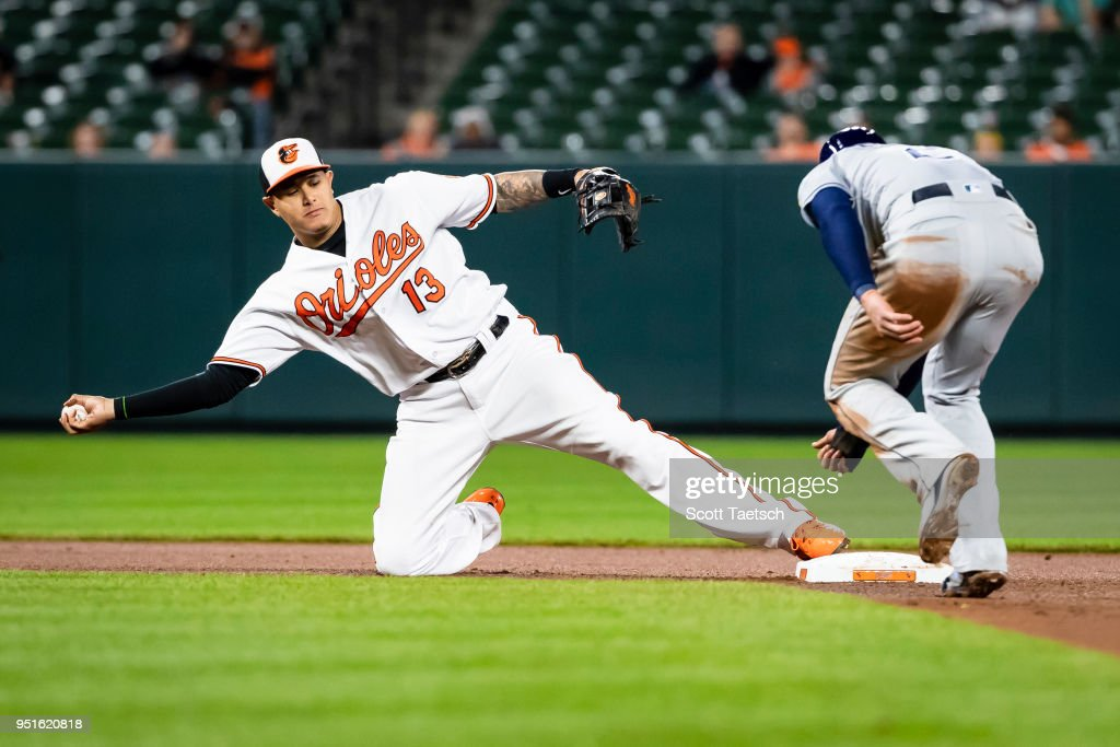 Manny Machado #13 of the Baltimore Orioles tags second base to put out Daniel Robertson #28 of the Tampa Bay Rays during the seventh inning at Oriole Park at Camden Yards on April 26, 2018 in Baltimore, Maryland.