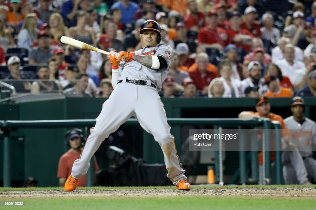 Manny Machado #13 of the Baltimore Orioles takes a ball against the Washington Nationals at Nationals Park on June 21, 2018 in Washington, DC.