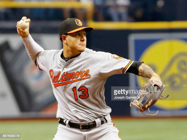 Manny Machado of the Baltimore Orioles throws a runner out in the bottom of the second inning of the game against the Tampa Bay Rays at Tropicana...