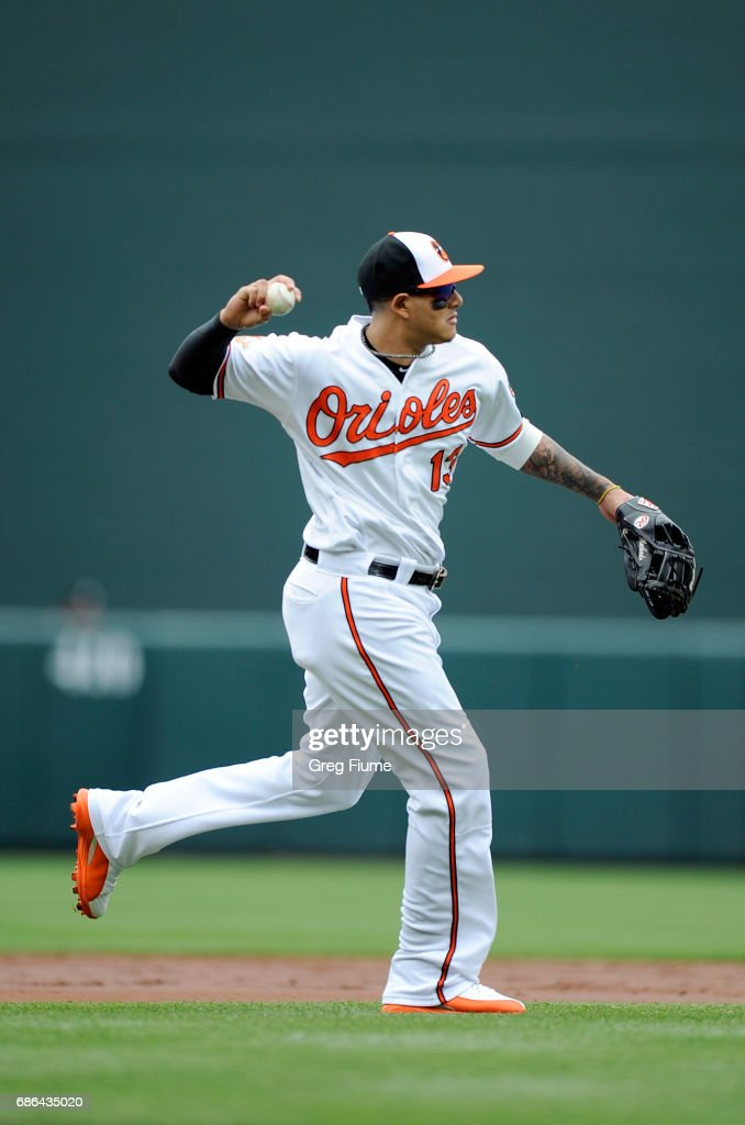 Manny Machado #13 of the Baltimore Orioles throws out Jose Bautista #19 (not pictured) of the Toronto Blue Jays in the third inning at Oriole Park at Camden Yards on May 21, 2017 in Baltimore, Maryland.