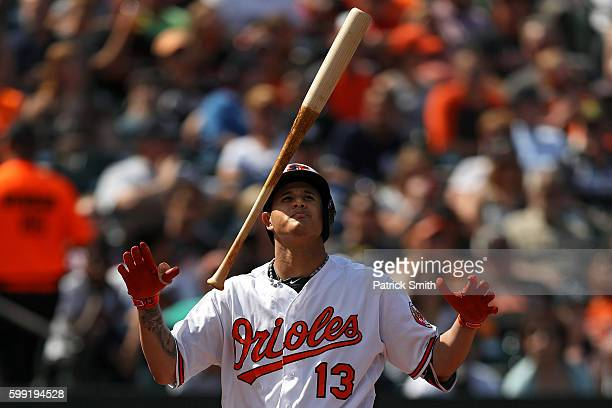 Manny Machado of the Baltimore Orioles tosses his bat after a pitcher against the New York Yankees during the third inning at Oriole Park at Camden...