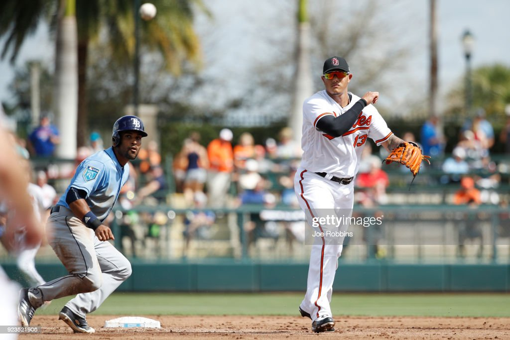 Manny Machado #13 of the Baltimore Orioles turns a double play against the Tampa Bay Rays during a Grapefruit League spring training game at Ed Smith Stadium on February 23, 2018 in Sarasota, Florida. The Rays won 6-3.