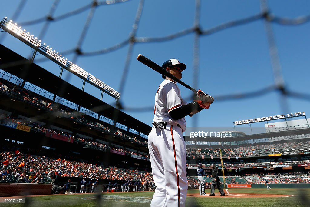 Manny Machado #13 of the Baltimore Orioles waits to bat in the first inning against the Tampa Bay Rays at Oriole Park at Camden Yards on April 10, 2016 in Baltimore, Maryland.