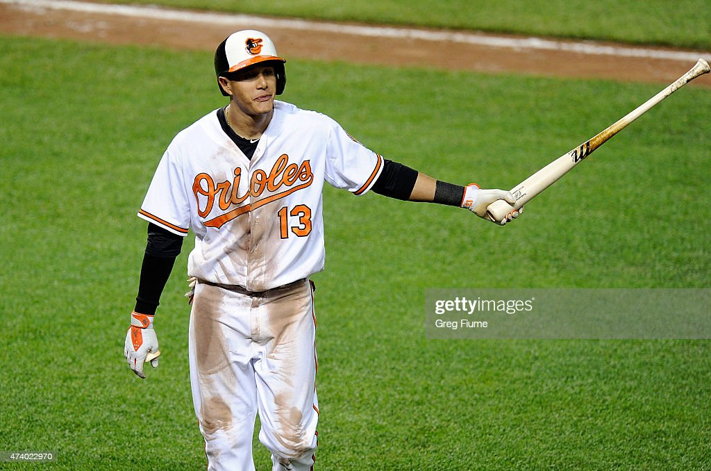 Manny Machado #13 of the Baltimore Orioles walks to the dugout after bunting a pop out to the Seattle Mariners pitcher in the sixth inning at Oriole Park at Camden Yards on May 19, 2015 in Baltimore, Maryland.