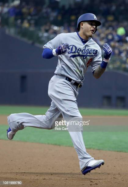 Manny Machado of the Los Angeles Dodgers celebrates after hitting a solo home run against Gio Gonzalez of the Milwaukee Brewers during the second...