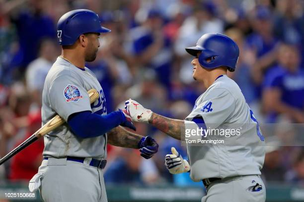 Manny Machado of the Los Angeles Dodgers celebrates with Matt Kemp of the Los Angeles Dodgers after hitting a solo home run against the Texas Rangers...