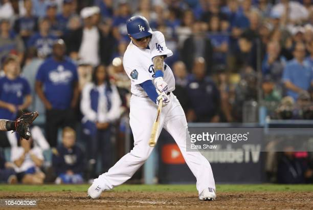 Manny Machado of the Los Angeles Dodgers flies out during the tenth inning against the Boston Red Sox in Game Three of the 2018 World Series at...