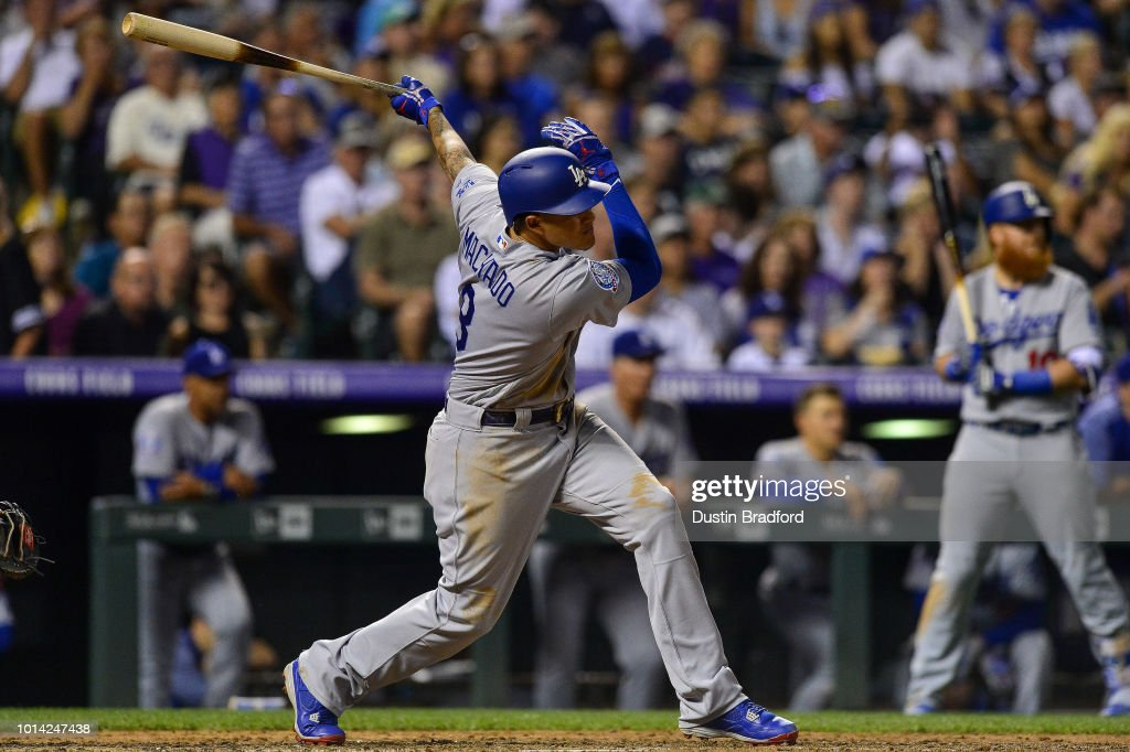 Manny Machado #8 of the Los Angeles Dodgers follows hits his 1,000th career single in the sixth inning of a game against the Colorado Rockies at Coors Field on August 9, 2018 in Denver, Colorado.