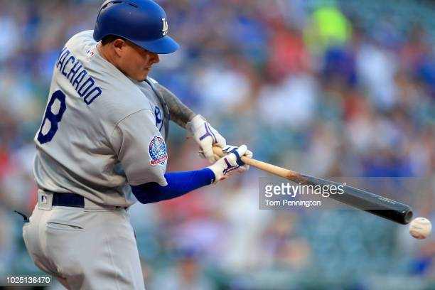 Manny Machado of the Los Angeles Dodgers fouls off a pitch against the Texas Rangers in the top of the first inning at Globe Life Park in Arlington...