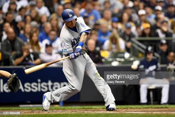 Manny Machado of the Los Angeles Dodgers hits a solo home run against Gio Gonzalez of the Milwaukee Brewers during the second inning in Game One of...